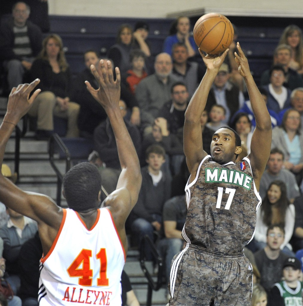 Darnell Lazare of the Maine Red Claws finds room to shoot over Shagari Alleyne of Albuquerque. The Red Claws won and remain fifth in the D-League overall standings.