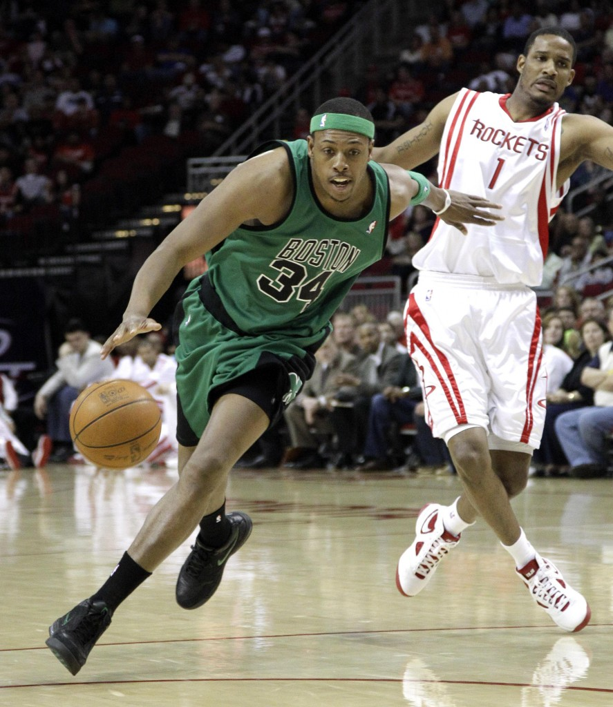 Boston's Paul Pierce drives past Houston's Trevor Ariza during the first quarter Friday night in Houston. Pierce scored 26 points and Ray Allen had 19 to lead the Celtics.