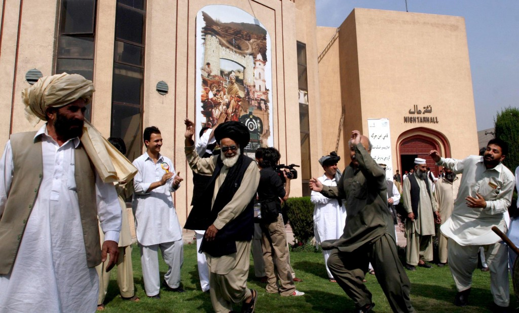 Pakistani tribesmen participate in traditional dance after tribal leaders gathered in Peshawar on Saturday. Hundreds of tribesmen from near the Afghan border took part in the meeting.