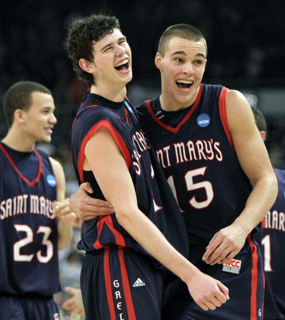Saint Mary's Trey Anderson (23), Clint Steindl, center, and Beau Levesque celebrate after beating Villanova 78-65 on, Saturday.