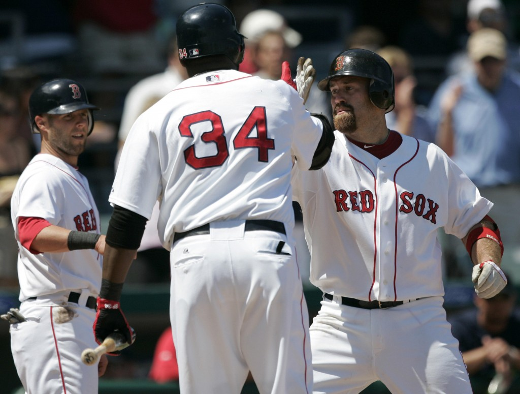 Kevin Youkilis of the Boston Red Sox, right, is greeted by David Ortiz, foreground, and Dustin Pedroia after hitting a two-run homer Saturday during a 6-0 victory over the Orioles.