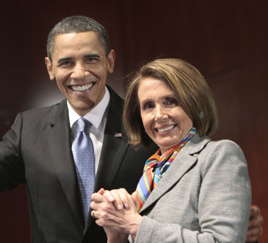President Obama stands with House Speaker Nancy Pelosi, D-Calif., during his visit to Capitol Hill to meet with House Democrats on Saturday to promote health care reform.