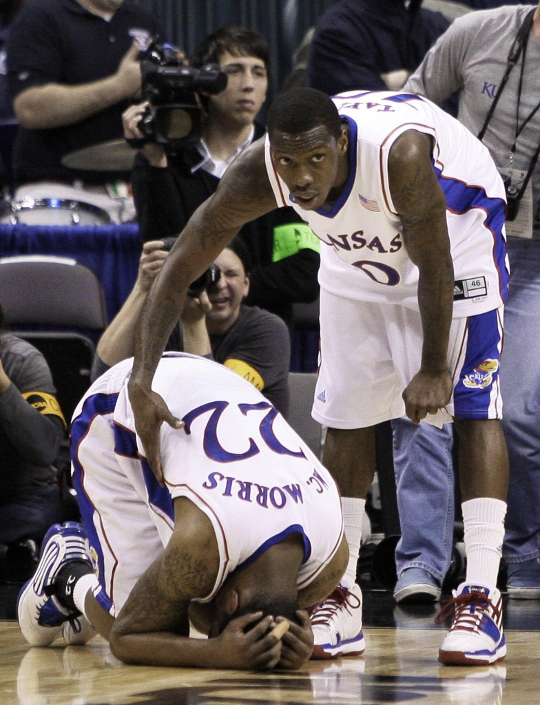 Tyshawn Taylor, right, of Kansas consoles Marcus Morris after the top-seeded Jayhawks got bounced from the NCAA tournament with a 69-67 second-round loss to Northern Iowa.
