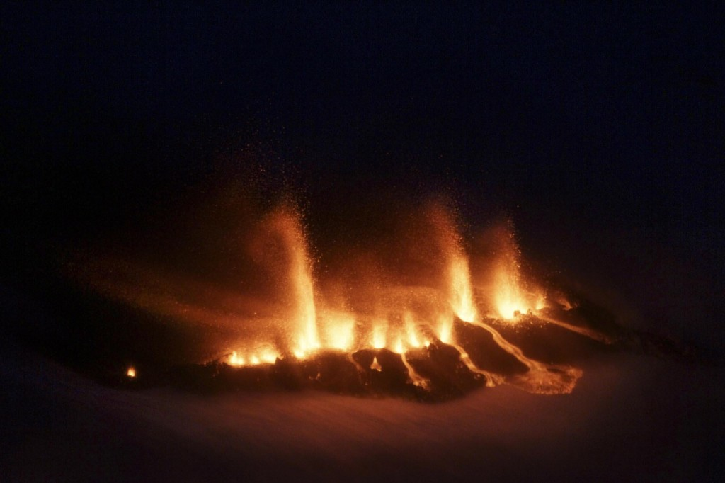 Aerial photo shows molten lava as it vents from a rupture near the Eyjafjallajokull glacier in Iceland, as a volcano erupts Sunday. Hundreds of people were evacuated from a small village in southern Iceland after the eruption shot ash and molten lava into the air, the first major eruption here in nearly 200 years.