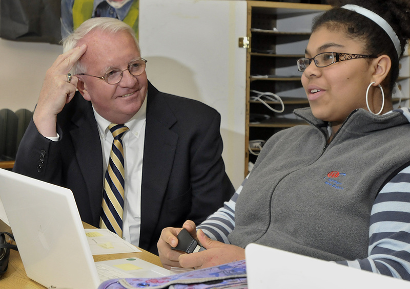 King Middle School Principal Mike McCarthy, Maine's Middle Level Principal of the Year, gets a briefing on seventh-grader Zoe Yeboah's recent interview with a civil rights activist in Maine who participated in the civil rights movement in the 1960s.
