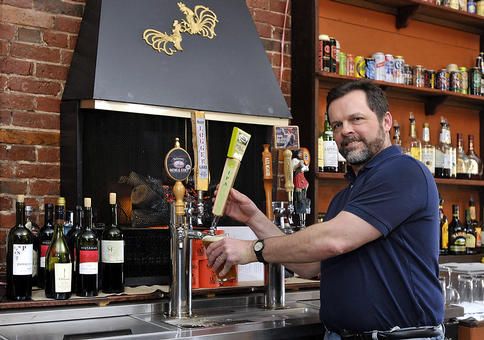 Bartender Steve Rowe draws an IPA at Lilee's Public House in Brunswick, where there are a large variety of brews and tasty food choices to go with them. The pub was opened about eight months ago by the restaurateurs behind the nearby Back Street Bistro.