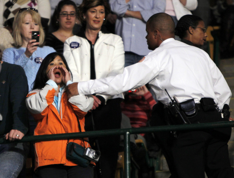 A protester is removed by a security officer as President Obama speaks about health care reform at the Patriot Center at George Mason University in Fairfax, Va., on Friday. Historians say such incivility is nothing new. What's different is that the Internet, social media and other outlets are airing raw, unfiltered comments.