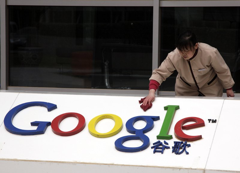 A Chinese worker cleans the Google logo at the Google China headquarters in Beijing, China, on Monday.