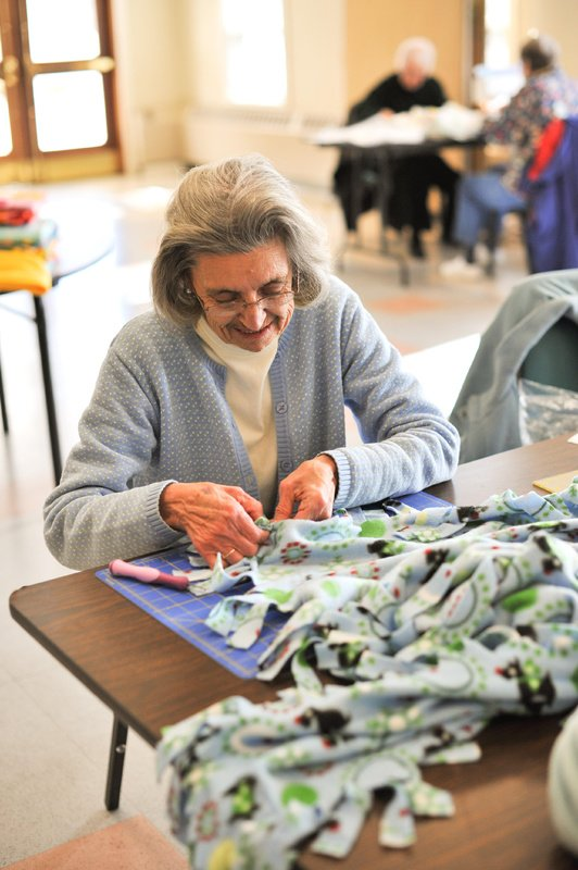 Nina Minnehan works on a fleece blanket a recent Blanket Day for the Cumberland County chapter of Project Linus.