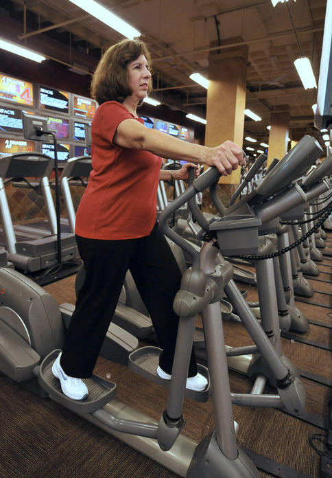 """Janet Katzin, 61, uses an elliptical machine at the X-Sport gym in Garden City, N.Y. """"I know I should go more, but that's all I can swing,"""" said Katzin, who exercises there for two hours a week."""