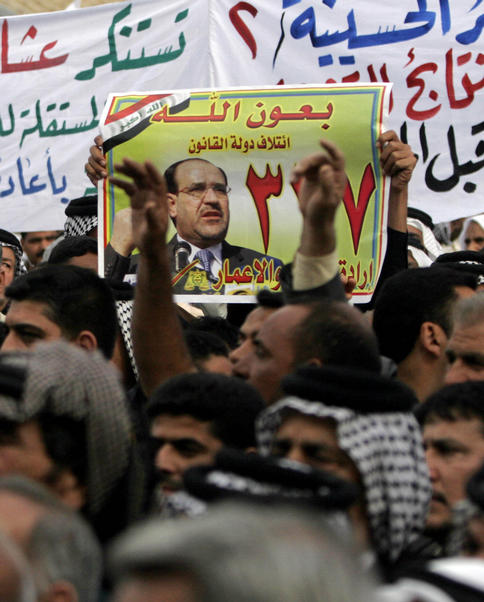 Supporters of Iraqi Prime Minister Nouri al-Maliki, seen in the poster, chant anti-Baathist slogans Wednesday during a protest in Karbala, Iraq. Hundreds of residents rallied to demand a manual recount of votes in the March 7 elections.