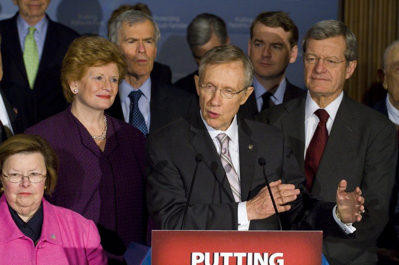 Senate Majority Leader Harry Reid of Nev., center, speaks during a news conference on Capitol Hill Thursday. From left are, Sen. Debbie Stabenow, D-Mich, Jeff Bingaman, D-N.M., Reid, Sen. Jeff Merkley, D-Ore., and Sen. Max Baucus, D-Mont.