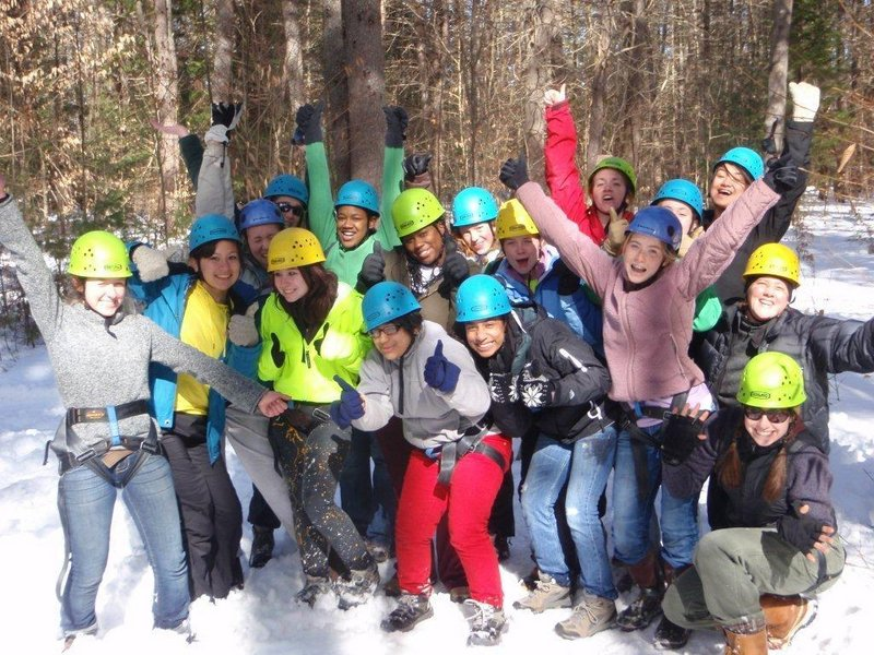 The pioneer class of Coastal Studies for Girls celebrates after their Ropes Course challenge.