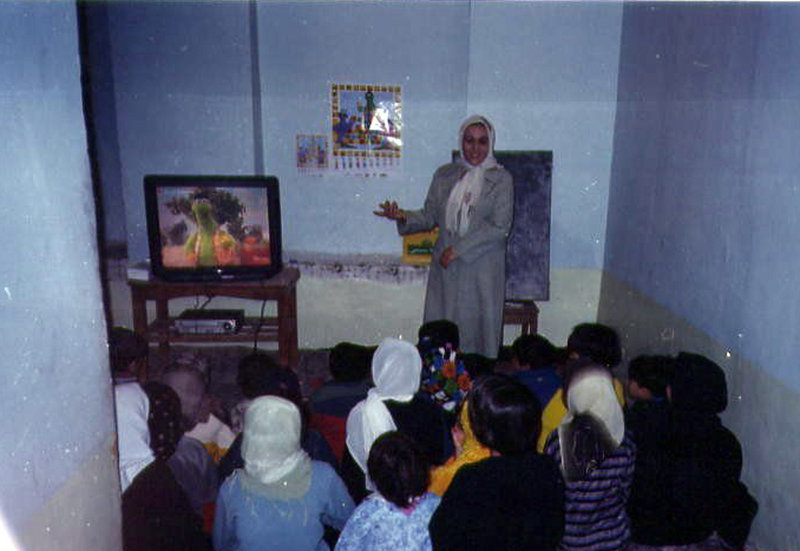 """Afghan children watch """"Koche Sesame,"""" an adaptation of """"Sesame Street."""" Some educators and TV producers in Afghanistan hope that the show will one day teach youngsters across the nation a gentler way of thinking."""