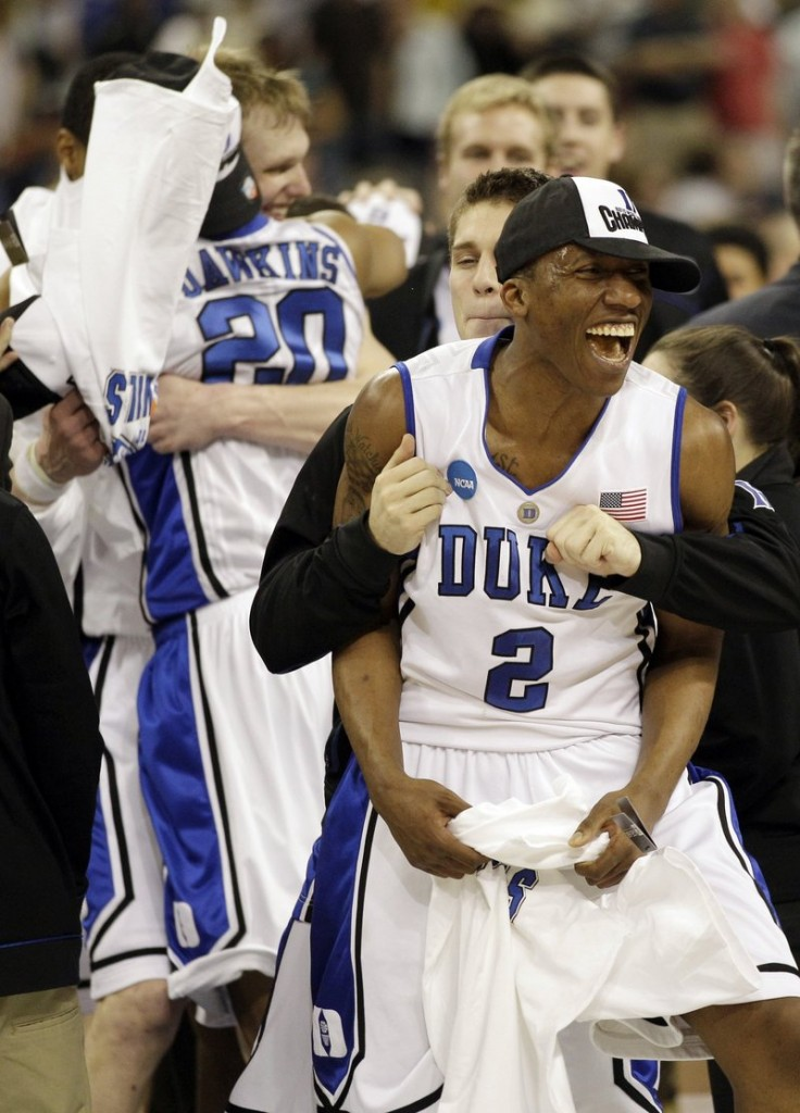 Nolan Smith leads the Duke celebration Sunday after a 78-71 win against Baylor in the NCAA South Regional final at Houston. The Blue Devils advanced to the Final Four for the first time in six years.