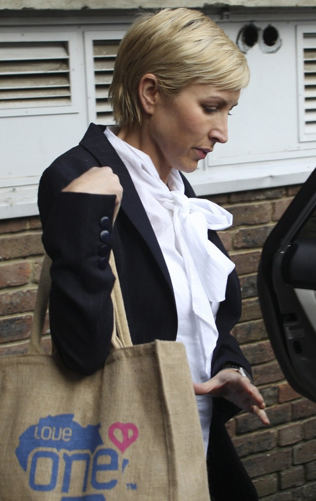 Heather Mills, former wife of British musician Paul McCartney, leaves an employment tribunal in Ashford, England, on Monday. Mills is being sued for sex discrimination by her ex-nanny, Sara Trumble.