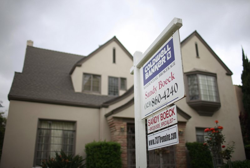 """A """"for sale"""" sign is posted Tuesday in front of a home in Los Angeles. A price increase of 1.8 percent in the city's real estate market in January helped lift a key home index for the eighth month in a row."""