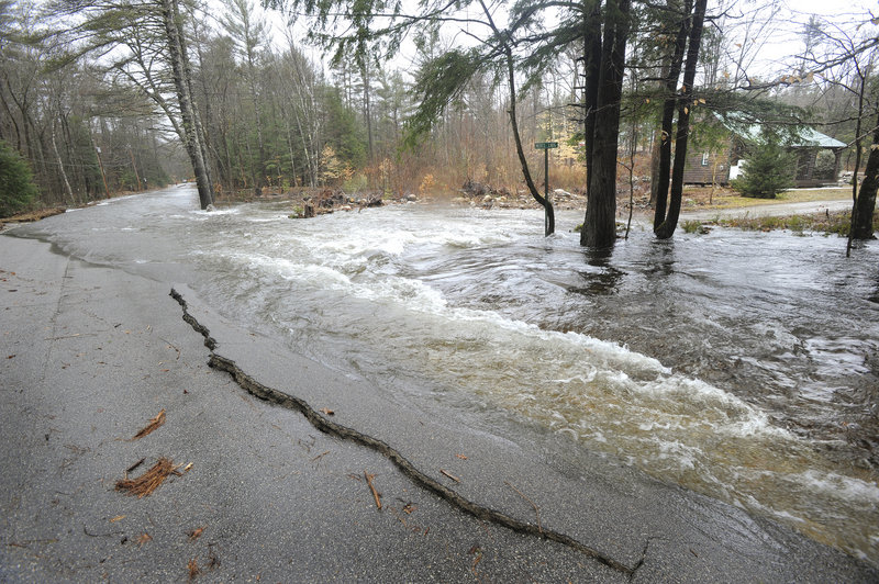 A dam break Tuesday morning causes flooding on Porter's Colcord Pond Road as well as part of the nearby Dam Road.