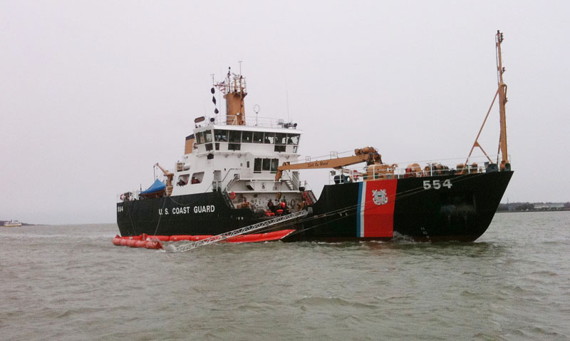 The U.S. Coast Guard vessel Marcus Hanna participates in an oil spill exercise under way in Portland Harbor today. The exercise simulates the cleanup of a spill of more than 70,000 gallons of crude oil.