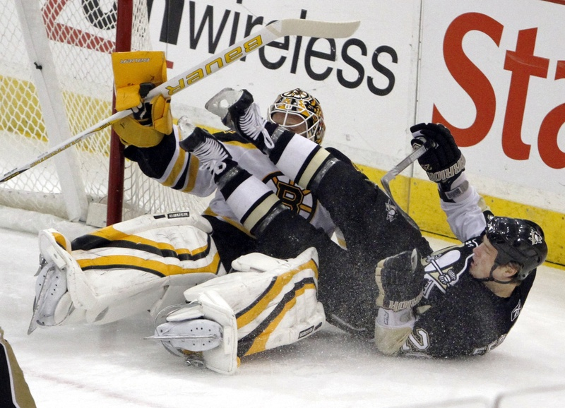Ruslan Fedotenko of the Penguins crashes into Bruins goalie Tim Thomas during Sunday's game in Pittsburgh. The Penguins improved to 4-0 since the Olympic break, beating Boston 2-1.
