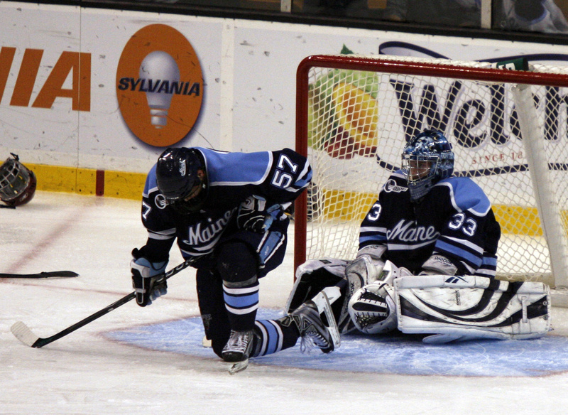 Matt Mangene and goalie Dave Wilson of the University of Maine absorb what just happened Saturday night immediately after Boston College scored the overtime goal that won the Hockey East title and brought the Black Bears' season to an end.