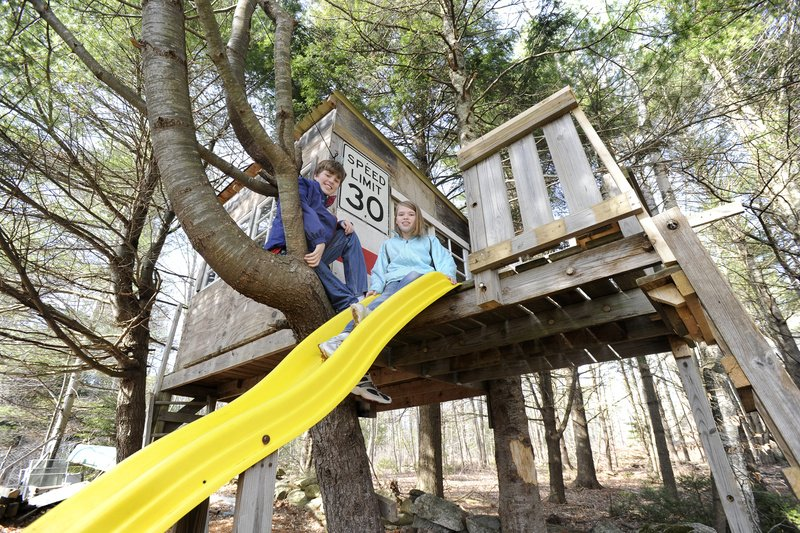 The Andersons of Freeport have a treehouse in their yard. Clifford, 14, and Allie, 11, can climb up and slide down.