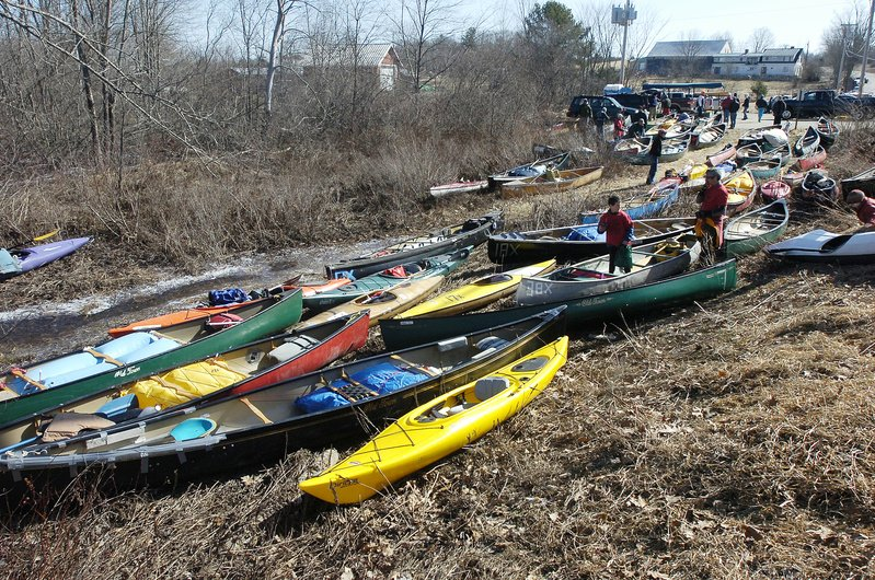 More than 100 of the canoes and kayaks registered to participate in this year's race gather along the riverbank in Searsmont for the March 27 contest.