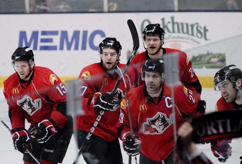 Felix Schutz, left, Marc-Andre Gragnani, Mike Kostka, back, Brad Larsen, front, and Mark Mancari celebrate Mancari's go-ahead goal in the first period Sunday against the Worcester Sharks. The Pirates won, 5-2.