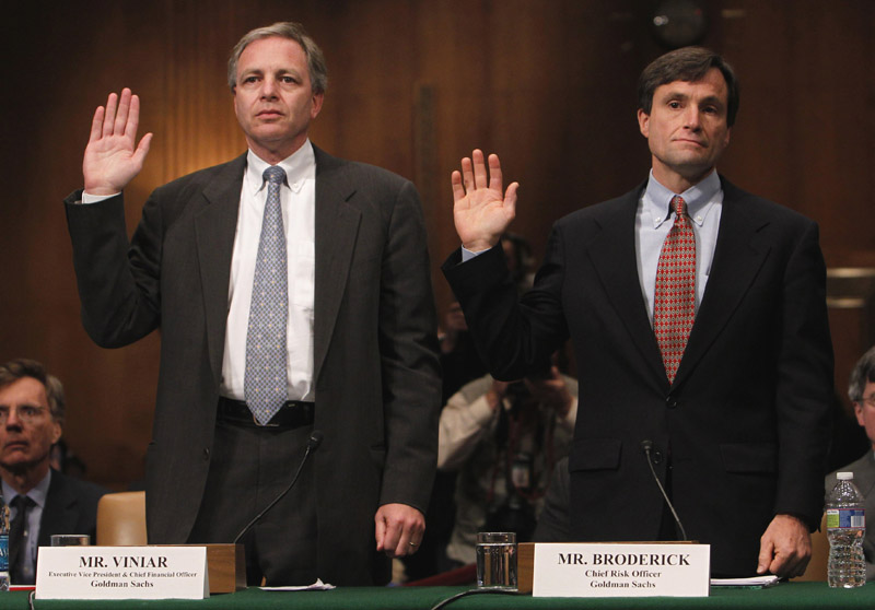 Goldman Sachs Executive Vice President and Chief Financial Officer David Viniar, left, and Chief Risk Officer Craig Broderick are sworn in on Capitol Hill today, prior to testifying before the Senate Investigations subcommittee hearing on Wall Street investment banks and the financial crisis.