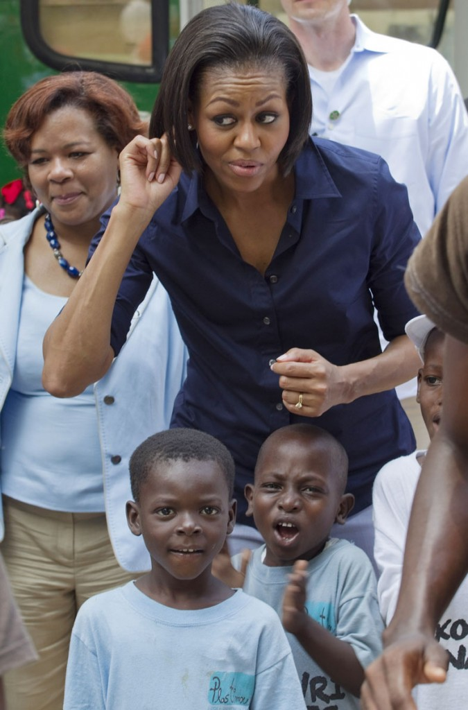 Michelle Obama gestures as she meets children in Port-au-Prince.