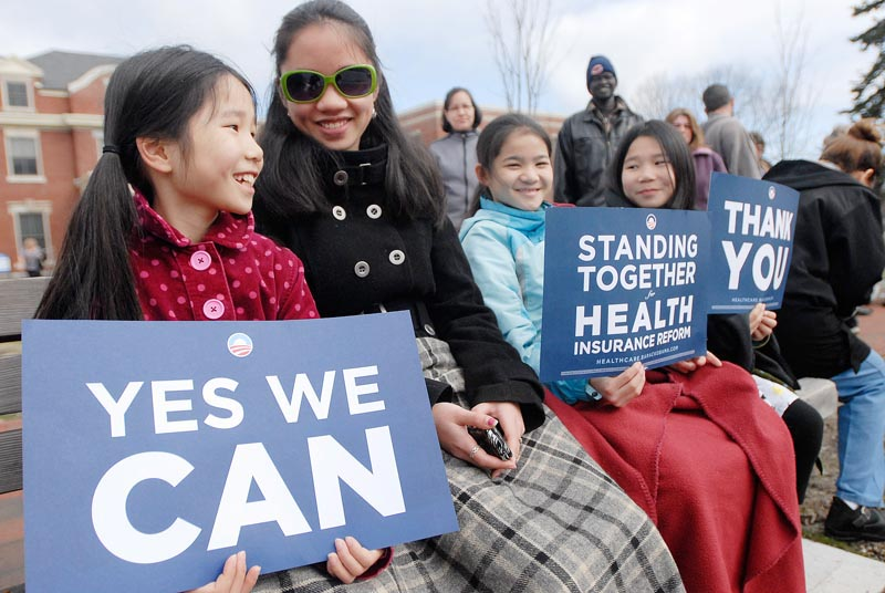 Obama supporters, from left, Mae Rosenstein 10, of Windham, Quinn Lavigne, 14, of Portland, Mira Wyman, 11, of Falmouth and Sylvie Rosenstein 10, of Windham wait in line to see the president today.
