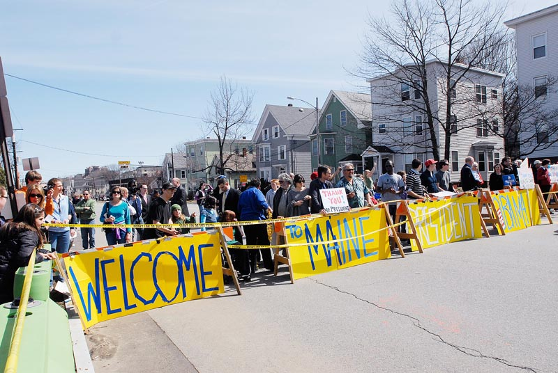A large sign welcomes President Obama to Maine outside the Expo.