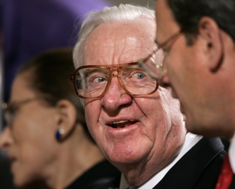 Associate Justice John Paul Stevens, center, smiles as he chats with Chief Justice John G. Roberts, right, in this 2006 file photo. Stevens, the court's oldest member and leader of its liberal bloc, is retiring.