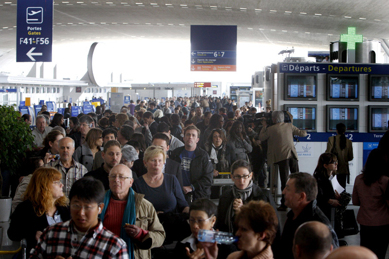 Travelers gather inside a terminal at the Roissy Charles de Gaulle Airport outside Paris on Friday, despite commercial flights being canceled by a plume of volcanic ash originating from Iceland.
