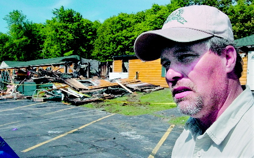 AFTERMATH: Grand View Topless Coffee Shop owner Donald Crabtree outside his business the morning of June 3 after it was destroyed by fire.