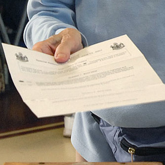 A voter submits a ballot in Saco in 2007.