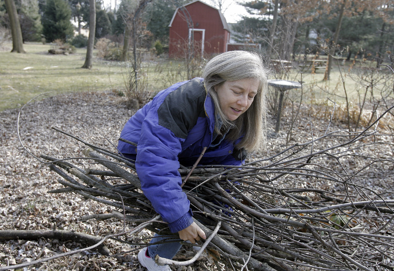 Marie Bertolette Page, 57, gathers sticks in her yard in Willow Grove, Pa. Page, who has a large garden and tends two other private gardens, swears by pilates and exercise class, as well as brisk walks and stretching to keep her muscles toned for gardening. Another important factor: Plan your work. Trying to do too much in a short period of time can lead to injuries.
