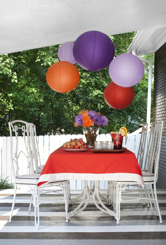 Flynn used porch and floor paint, paper lanterns and flea-market finds for an outdoor dining space.