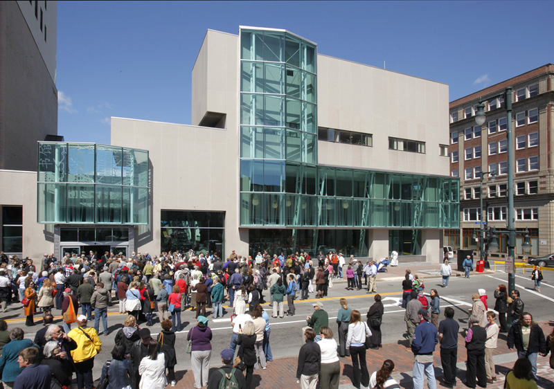 People gather on Congress Street, which was closed off for the grand reopening ceremony of the Portland Public Library on Thursday.
