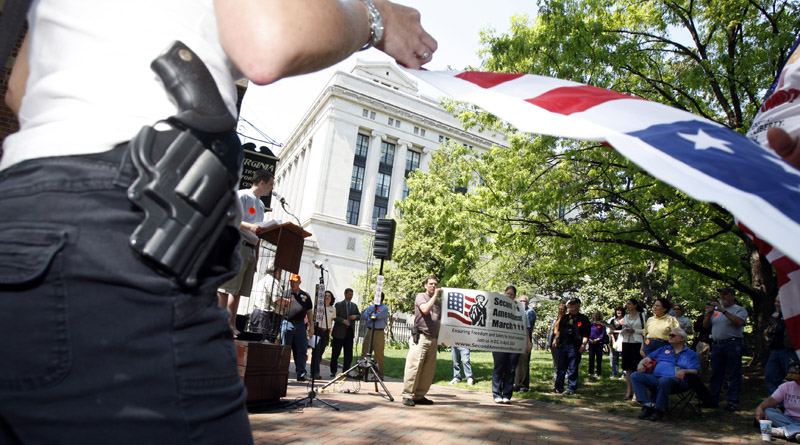 Participants openly carry handguns among a group of supporters that converged for the Virginia Second Amendment Rally on Capitol Square in Richmond, Va., on Monday.