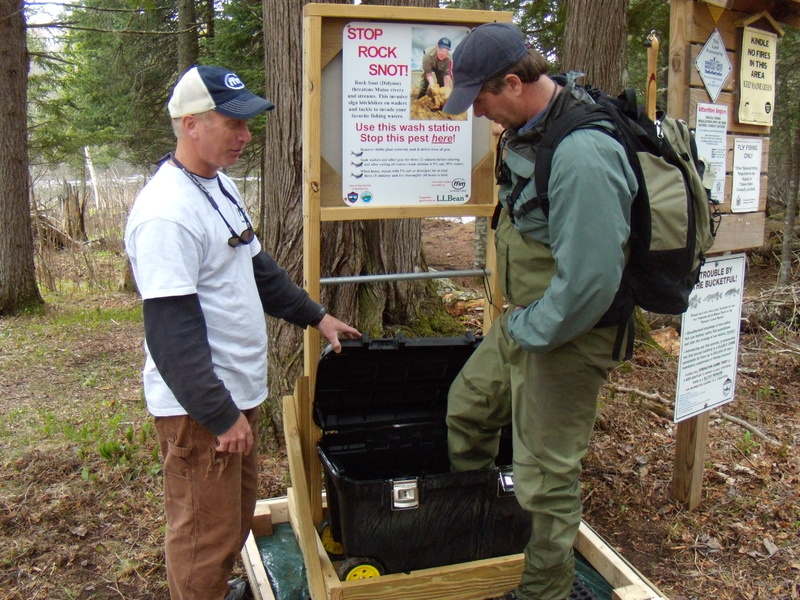 A wash station at the Rapid River last year. At rivers around Maine, fly fishermen will be asked and encouraged to clean up to keep the invasive algae didymo from gaining a foothold in the state. Didymo is in New Hampshire, New York and several other states.