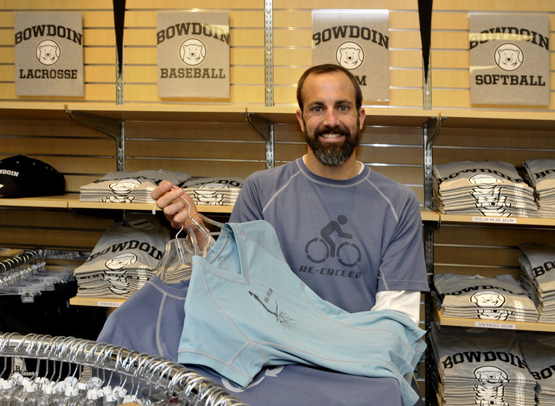 Jeremy Litchfield, seen at the Bowdoin College Store, holds workout gear made from recycled products by his Brunswick-based company, Atayne.