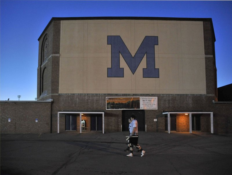 Students pass the UM fieldhouse on their way to practice. The school is vital to Maine's future prosperity, readers say.