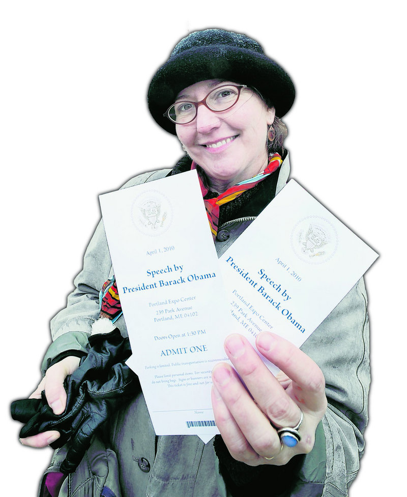 Jewelz Dellger of Portland holds the pair of tickets she scored Wednesday for today's presidential speech at the Portland Expo.