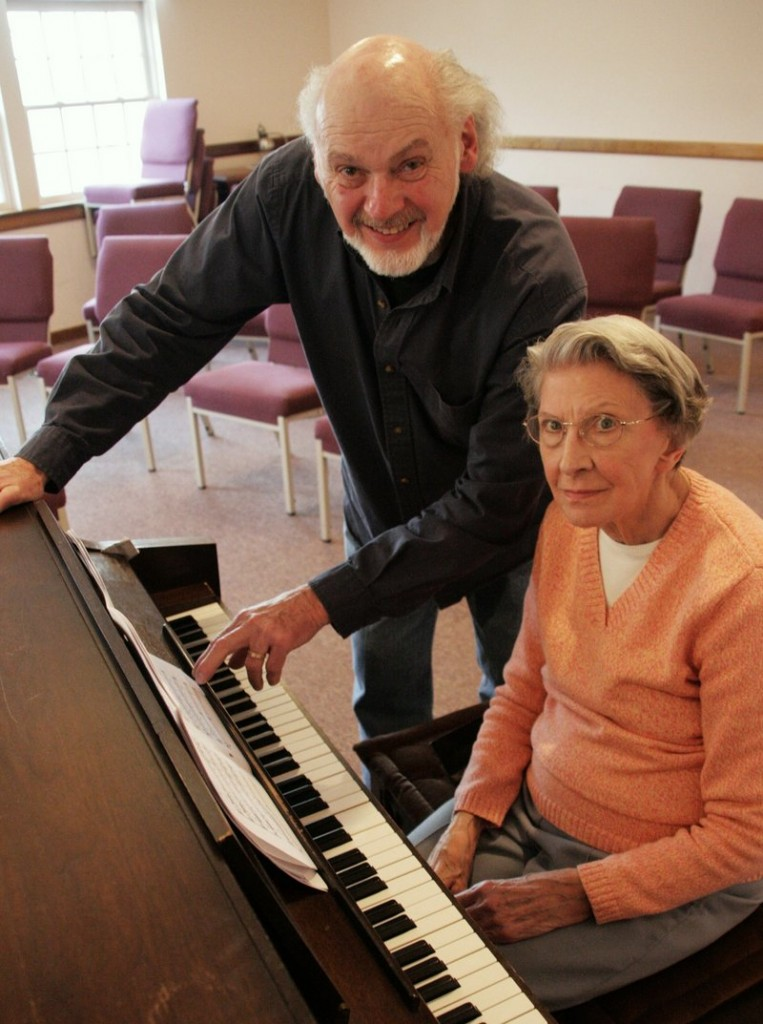 Harry Moon, director of the Community Chorus of South Berwick, and pianist Audrey Adams review a score for the group''s concerts this weekend.