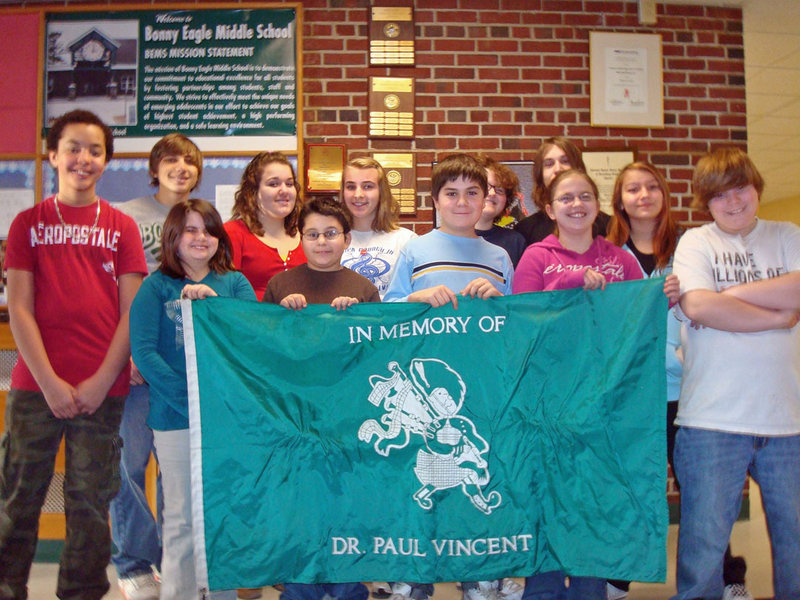The Bonny Eagle Middle School Civil Rights Team and some Drama Club students have collaborated to write, act and film skits detailing different kinds of bullying and harassment in school. Here, they pose with the school's honor flag, during a ceremony celebrating their work. Pictured are from left, front, Rose Michaelson, Roscoe Deering, Evan Gillingham and Stevie Buck; and rear, Mason White, Waice McKenzie, Sarah Poore, Autumn London, Carter Gleason, Austin Leach, Sabrina Frost and Josh Brown.