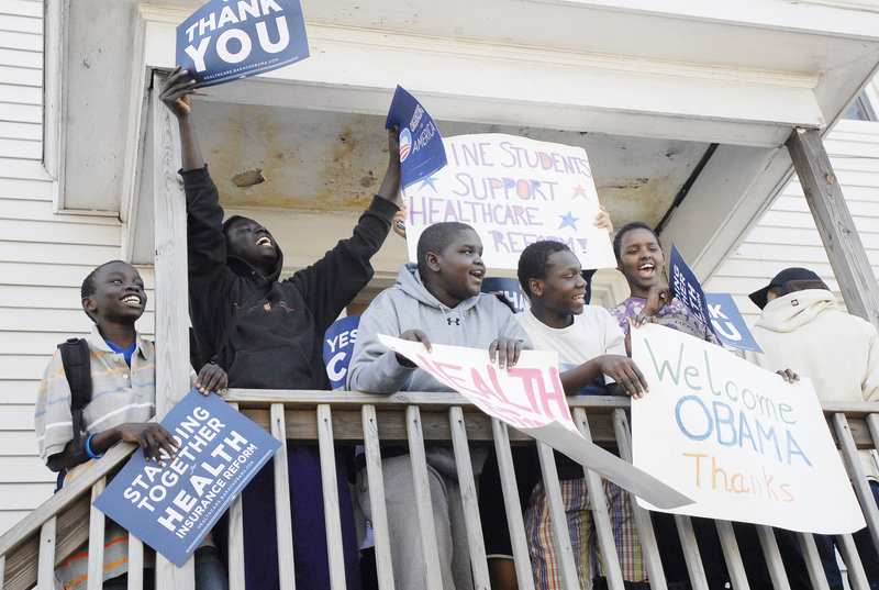 """Youths chant """"Obama, Obama"""" on a porch across the street from the Expo. """"He took a complicated issue and broke it up in a way everyone could understand it,"""" said U.S. Rep. Chellie Pingree."""
