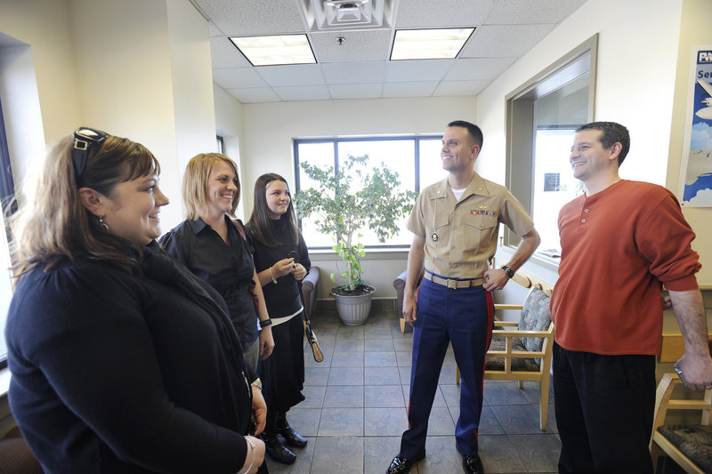 Marine Maj. Jeremy Deveau from East Millinocket, second from right, flew the helicopter carrying President Obama to the Portland International Jetport. Relatives greeted him at Northeast Air and proceeded to get a tour of the White Hawk aircraft.
