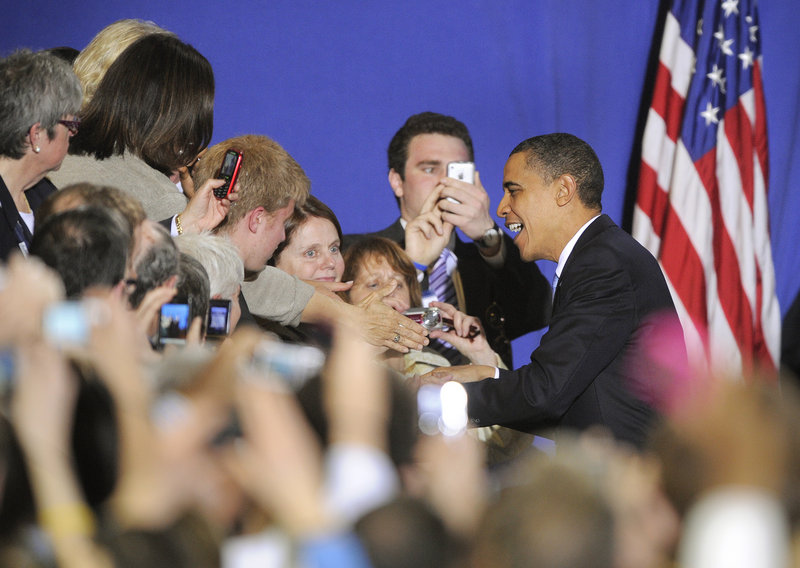 President Obama arrives Thursday for his appearance at the Portland Expo. The crowd of more than 2,000 people roared and waved when the president entered, and later drowned out parts of his speech with applause and cheers.