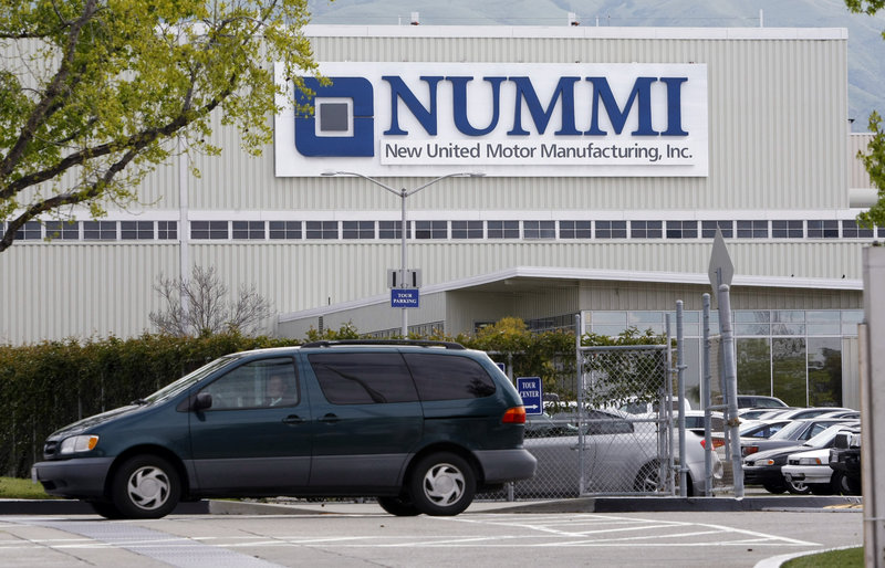 A worker leaves the New United Motor Manufacturing Inc. plant in Fremont, Calif., on Thursday, the last day of operations for the plant in Fremont. The Nummi plant, established in 1984 as a joint venture between GM and Toyota Motors Corp., employed 4,700 workers.